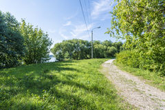 Dirt road in the summer Russian field Royalty Free Stock Photography