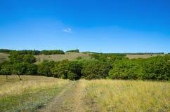 Dirt road and terrain Donetsk range. Royalty Free Stock Photography