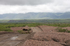 Dirt road with threatening sky and the Zebra mountains, Namibia Royalty Free Stock Photos