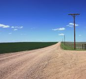 Dirt road thru a rural area Stock Photos