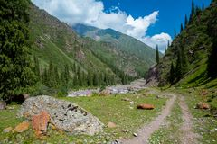 Dirt road in Tien Shan mountains, Kyrgyzstan Stock Image