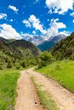 A dirt road in the Tien Shan mountains in the spring Stock Image