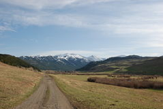 Dirt Road to Crazy Mountains Royalty Free Stock Photo