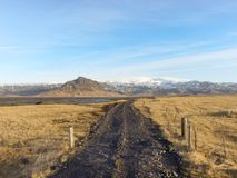 Dirt road to Klifandi river and Myrdalsjokull glacier, south Iceland in winter stock images