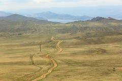 Dirt road to Olkhon island, Lake Baikal, Russia Royalty Free Stock Photography