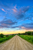 Dirt road to sunset Royalty Free Stock Photo