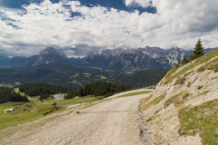 Dirt road on top of a mountain. With artificial lake Royalty Free Stock Images