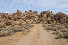 Dirt Road Toward Boulders Royalty Free Stock Photo