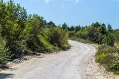 Dirt road turning left Stock Images