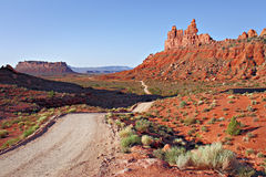 Dirt road through valley of the gods Stock Images