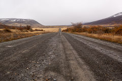 Dirt Road Vanishing. Into the distance down a hill Stock Photo