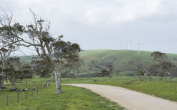 Dirt Road and Wind Turbines, Fleurieu Peninsula, South Australia. South Australian bush dirt road with wind turbines busily generating electricity on the hills Stock Photography