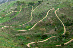 Dirt road winding. Dirt road that climbs the mountains of Erice to Trapani royalty free stock images
