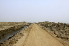 Dirt roads and drainage ditch Royalty Free Stock Photography