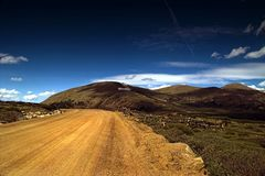 Dirt Rural Country Mountain Road in Colorado. With sky and clouds royalty free stock images