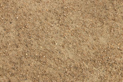 Dirt and small stones textured background stock photography