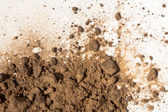 Dirt and soil on white background. Light brown soil on white background Stock Photography