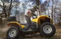 Dirt spinning of the ATV quad bike wheels Stock Image