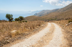 Dirt track in the Mediterranean countryside with mountains, sea Royalty Free Stock Photography