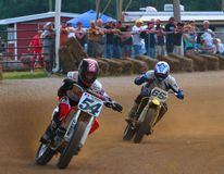Dirt track motorcycle race. Racing motorcycles make the tight turn on the dirt racing track Stock Photography