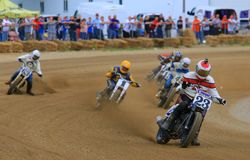 Dirt track motorcycles. Racing motorcycles make the turn on the dirt racing track Stock Photo