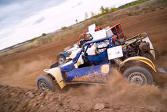 Dirt track racing. Sprint cars (buggy) in a dirt track Stock Photos