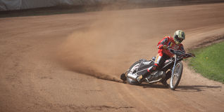 Dirt-track rider at high speed Royalty Free Stock Photos