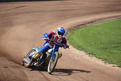 Dirt Track Rider taking a curve. Sibiu, Romania - April 27, 2013: Speedway Romania - Dirt Track National Championship. Unidentified riders participating at stock image