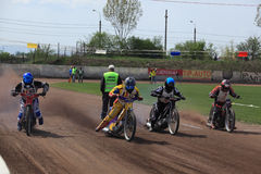 Dirt track riders at start royalty free stock image