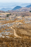 Dirt Trail at Hiraodai Karst Plateau. A trail leads through the otherworldly landscape of Hiraodai Karst Plateau in Hiraodai Quasi-National Park in Kitakyushu royalty free stock image