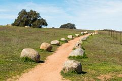 Dirt Trail Lined with Boulders at Ramona Grasslands Preserve Stock Photos