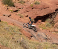 A dirtbike at the cliffhanger competition on labor day in moab. A rider testing his skills on a rugged track through a canyon in utah Stock Images