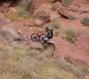 A dirtbike at the cliffhanger competition on labor day in moab. A rider testing his skills on a rugged track through a canyon in utah Royalty Free Stock Images