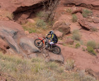 A dirtbike at the cliffhanger competition on labor day in moab. A rider testing his skills on a rugged track through a canyon in utah Stock Photo