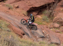 A dirtbike at the cliffhanger competition on labor day in moab. A rider testing his skills on a rugged track through a canyon in utah Stock Photos