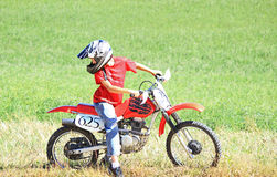 Dirtbike Rider. A young boy riding his dirtbike in the country royalty free stock photo