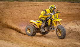 Dirtbike 3 Wheeler Action Scene. Motorcyclist making a hard turn during a MX motocross race Royalty Free Stock Images