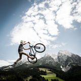 Dirtbiker jumps high Royalty Free Stock Image
