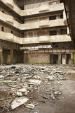 Dirty abandoned building interior in ruins in warm tone. Vertical format Stock Photography