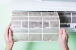 Dirty air conditioner filter. Need cleaning stock images