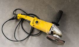 Dirty angle grinder on concrete Stock Photography