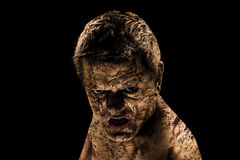 A dirty and angry man. With black background Stock Image