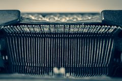 Dirty antique typewriter focusing on the typebars. With a retro feel Royalty Free Stock Photography