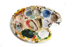 Dirty artist's palette with paints Royalty Free Stock Photos
