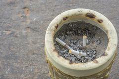 Dirty ashtray. Cigarettes in a dirty ashtray royalty free stock images