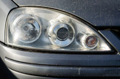 Dirty Automobile Headlight Royalty Free Stock Photos