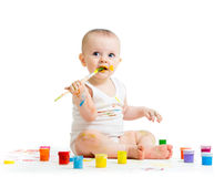 Dirty baby drawing with a finger's paints Royalty Free Stock Photos