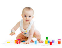 Dirty baby with finger paints Royalty Free Stock Image
