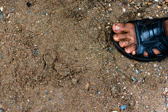 Dirty and bare child`s feet on gravel - Poor people and human po Stock Photos