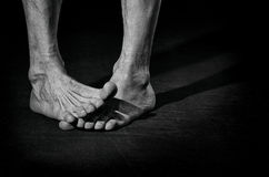 Dirty bare feet. Dirty, barefoot, funny crossed male legs Royalty Free Stock Photo